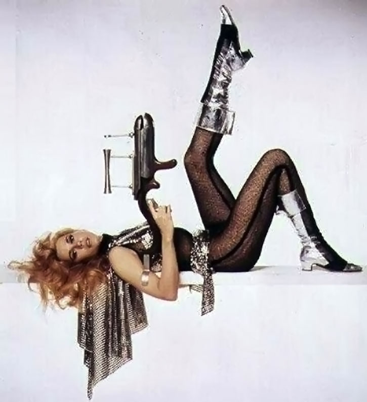 Barbarella poses with gun