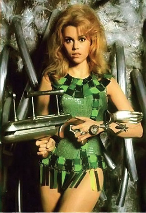 Barbarella (Jane Fonda) with green mini-dress and strange weapons