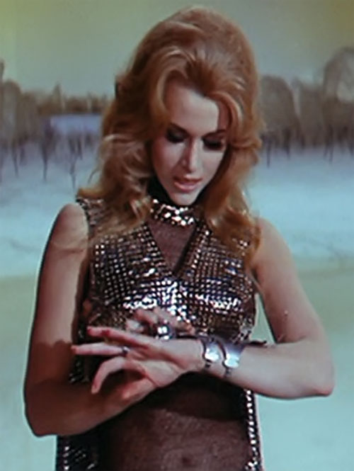 Barbarella (Jane Fonda) checking her bracer