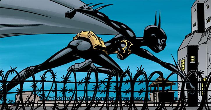Batgirl (Cassandra Cain) runs atop a prison wall