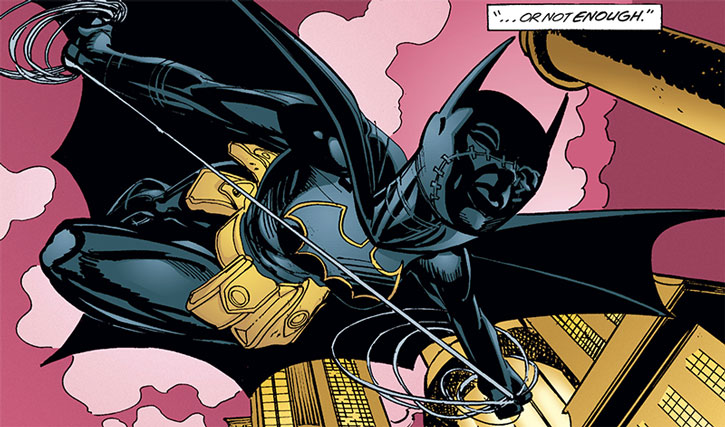 Batgirl (Cassandra Cain) using a swingline