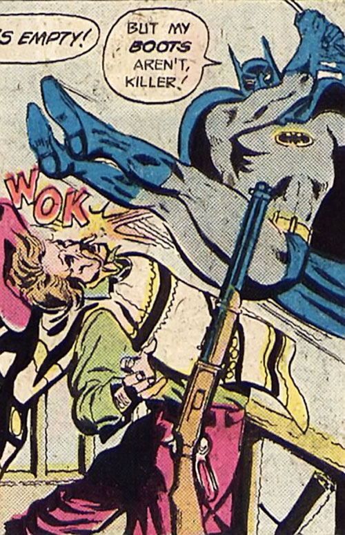 Batman Jr. (DC Comics Super-Sons) kicks a rifleman