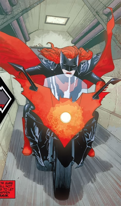 Batwoman (Katherine Kane) (DC Comics modern) driving her motorcycle down a corridor