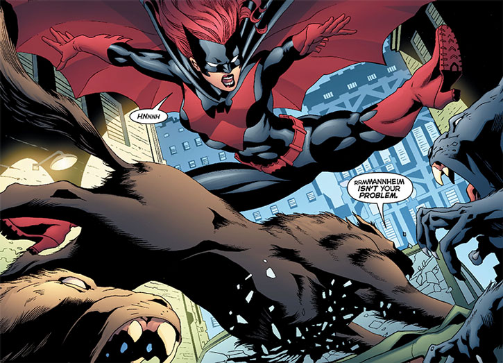 Batwoman (Kate Kane) dodges beast-men