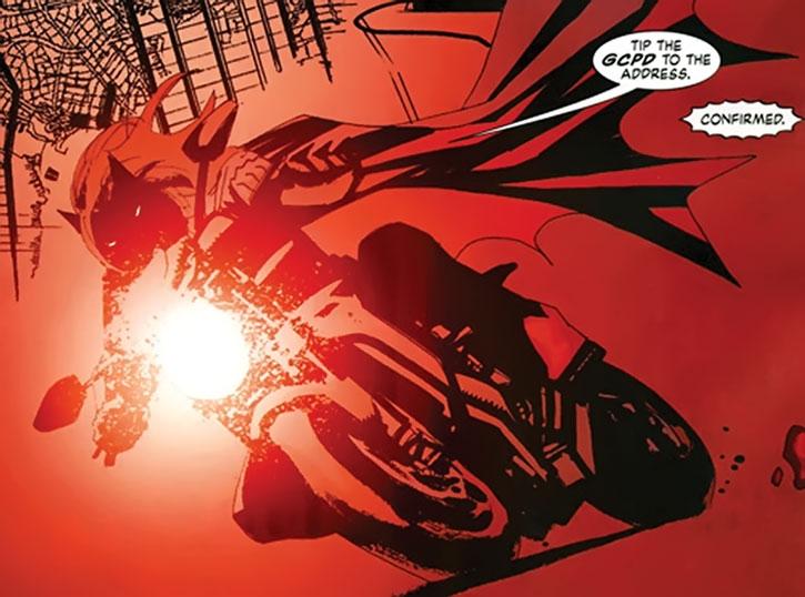 Batwoman (Kate Kane) rides her motorbike
