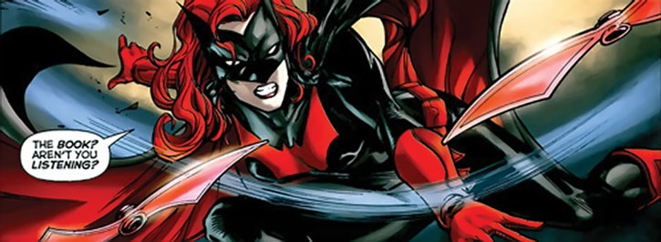 Batwoman (Kate Kane) throwing batarangs