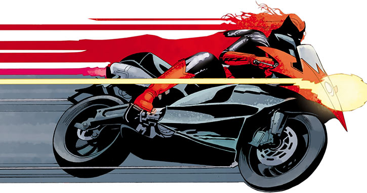 Batwoman (Kate Kane) on her Ducati