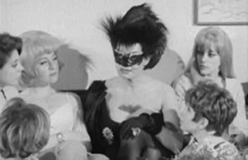 Wild Wild Batwoman (Katherin Victor in She Was a Hippy Vampire) talking to her batgirls