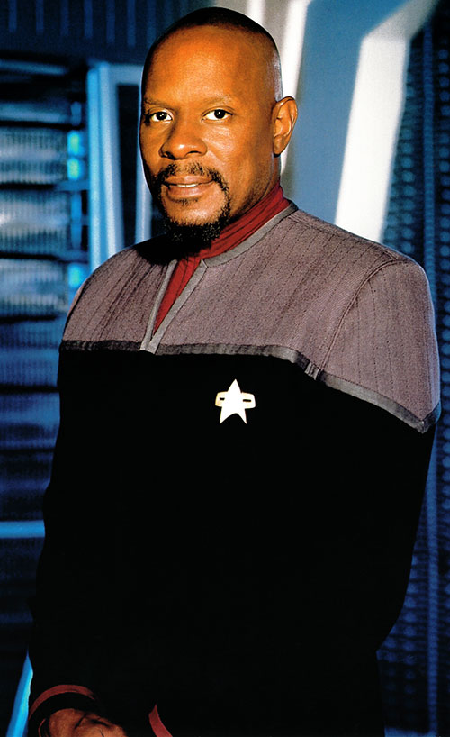 Captain Benjamin Sisko (Avery Brooks in Star Trek) in a gray uniform