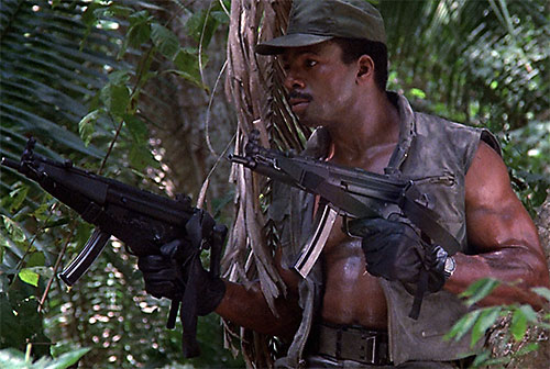 Dillon (Carl Weathers in Predator) dual-wielding MP5s