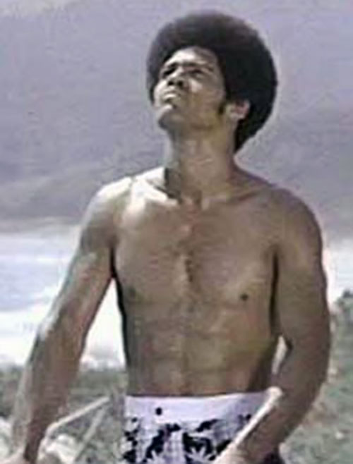 Jim Kelly as Black Belt Jones, bare-chested
