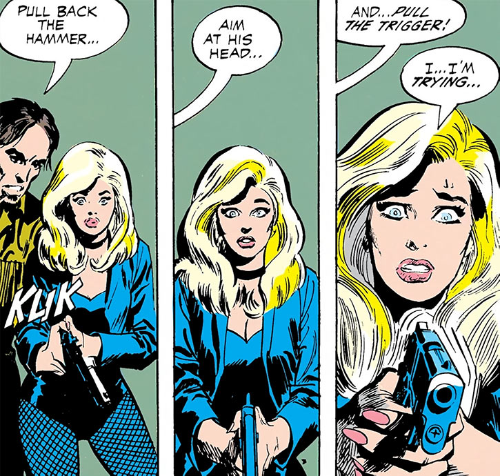 Black Canary (DC Comics) (1970s) hypnotised with handgun