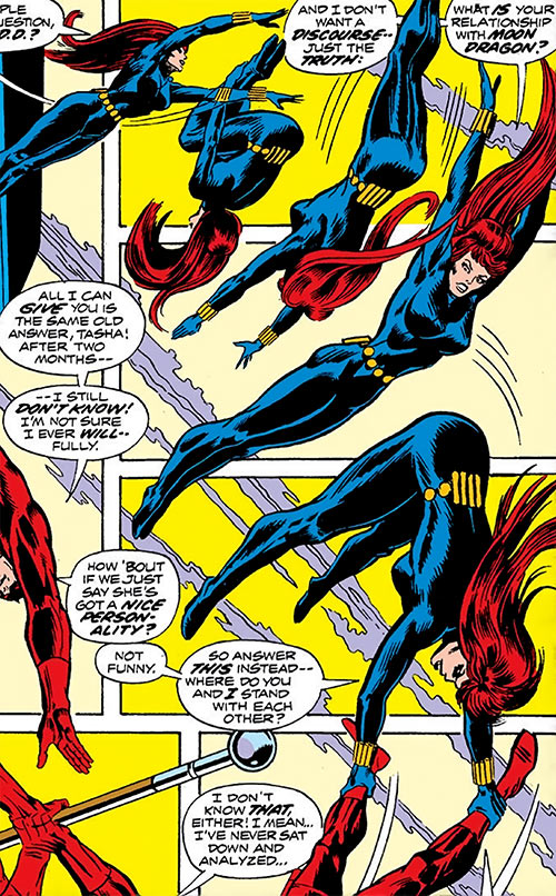 Black Widow (1970s Marvel Comics) doing acrobatics with Daredevil