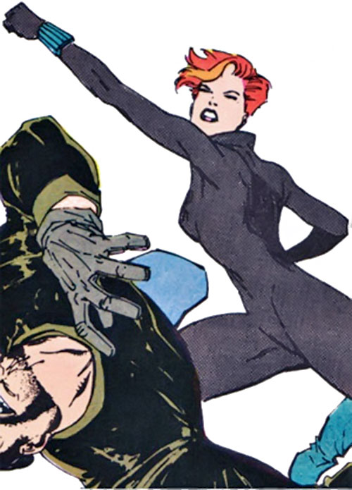 Black Widow (1980s Marvel Comics) punching a guy