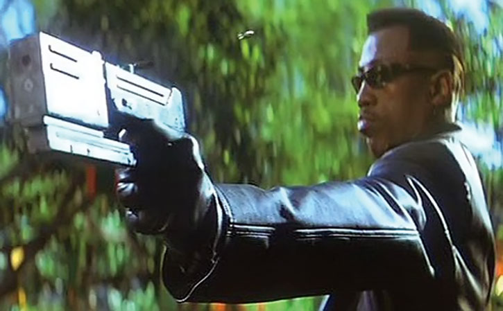 Blade shooting one of his machine pistols