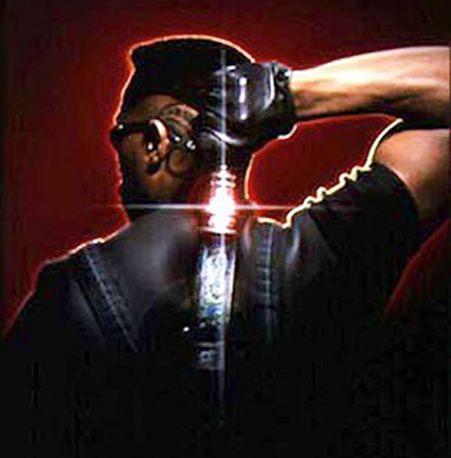 Blade (Wesley Snipes) draws the sword on his back sheath