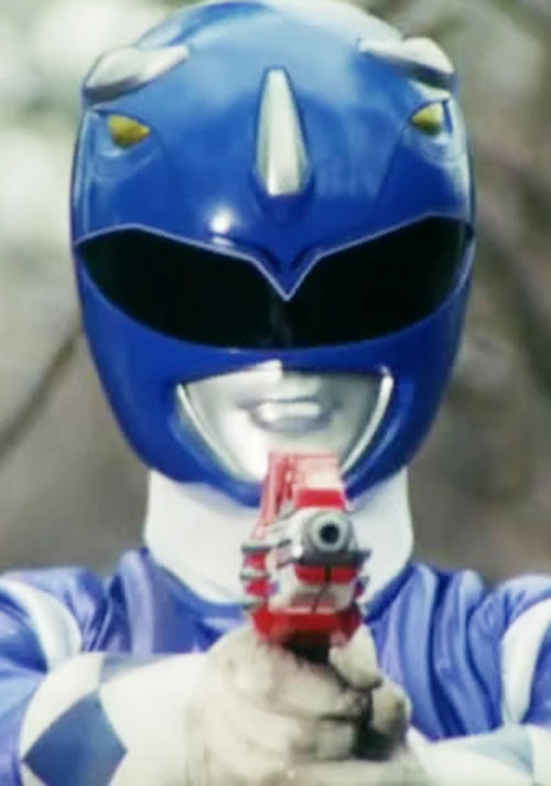 Blue Ranger (Billy) of the Mighty Morphin' Power Rangers (Early) aiming a pistol