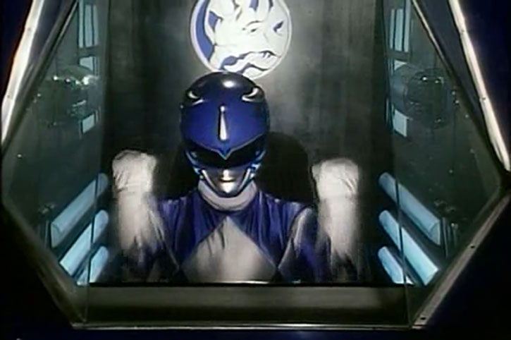 Blue Ranger (Billy) of the Mighty Morphin' Power Rangers (Early) in his cockpit