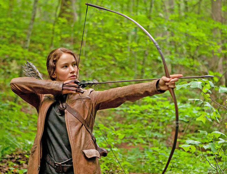 Katniss Everdeen aims a simple bow