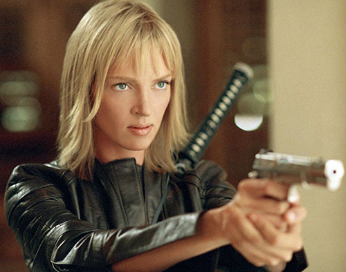 The Bride (Beatrix Kiddo) (Uma Thurman) (Kill Bill) pointing a pistol
