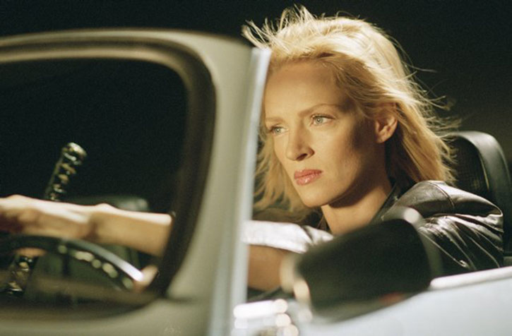 The Bride (Uma Thurman) driving a convertible