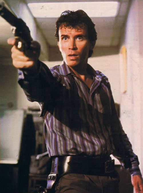 Buckaroo Banzai (Peter Weller) pointing a revolver