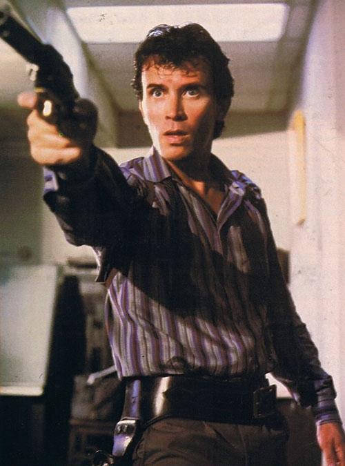 Buckaroo Banzai (Peter Weller) pointing a revolver