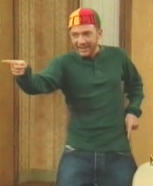 Bud Bundy (David Faustino in Married with Children) gesturing with a colourful cap
