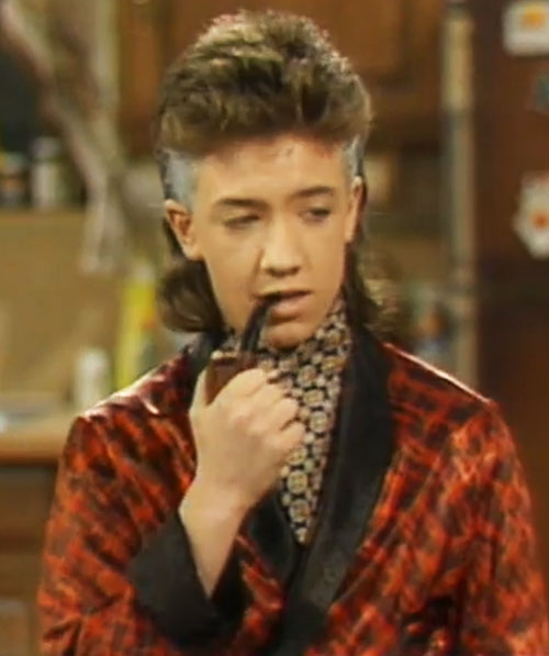 Bud Bundy (David Faustino in Married with Children) with a pipe and his temples dyed gray