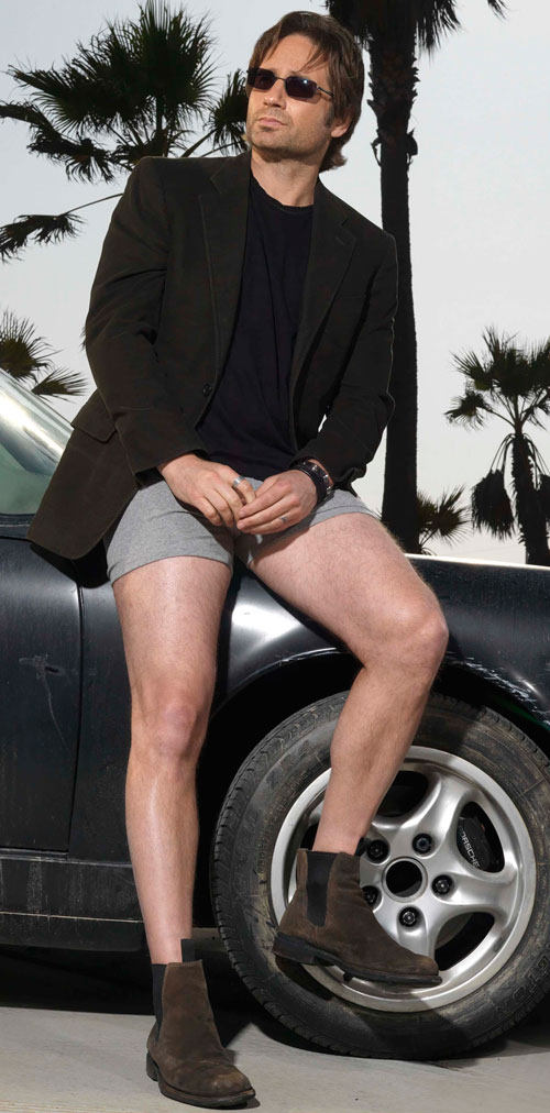 Hank Moody (David Duchovny in Californication) posing in a suit vest and boxer shorts