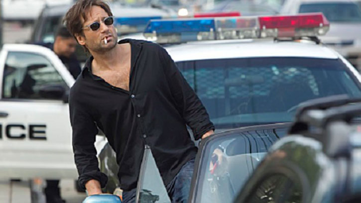 Hank Moody (David Duchovny in Californication) haggard in the L.A. traffic