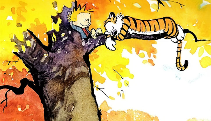 Calvin and Hobbes in a tree during Autumn