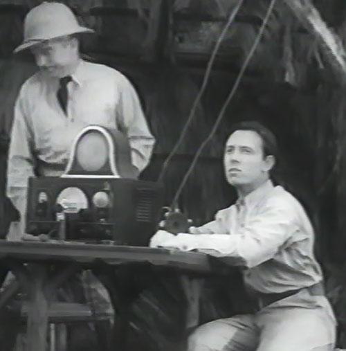 Captain Marvel (1941 Republic serial) - Billy Batson next to the radio