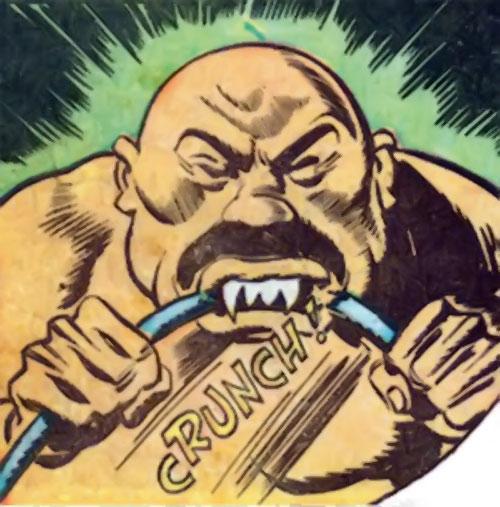 Captain Nippon (Captain Marvel enemy) (Golden Age DC Comics) biting through a steel bar