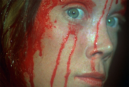 Stephen King's Carrie (Sissy Spacek) blood-covered face closeup