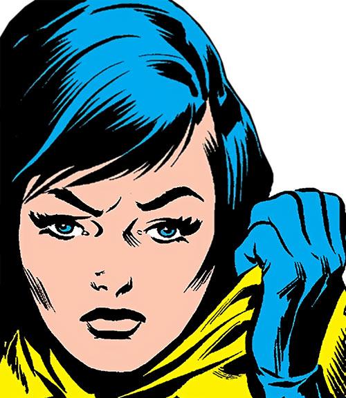 The Cat (Greer Nelson) (Marvel Comics) taking off her cowl