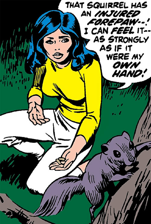 The Cat (Greer Nelson) (Marvel Comics) in her civvies with a squirrel