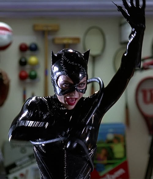 Catwoman (Michelle Pfeiffer) (Batman Returns 1992 movie) drawing her whip