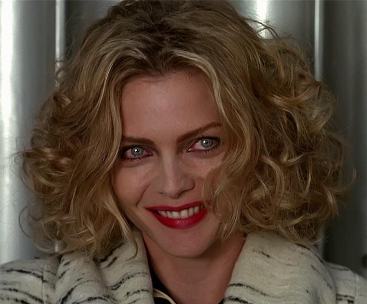 Catwoman (Michelle Pfeiffer) (Batman Returns 1992 movie) grin bloodshot eyes
