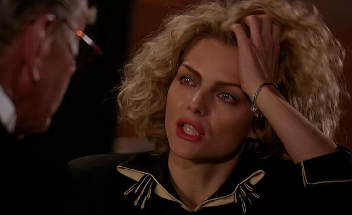 Catwoman (Michelle Pfeiffer) (Batman Returns 1992 movie) feeling awkward