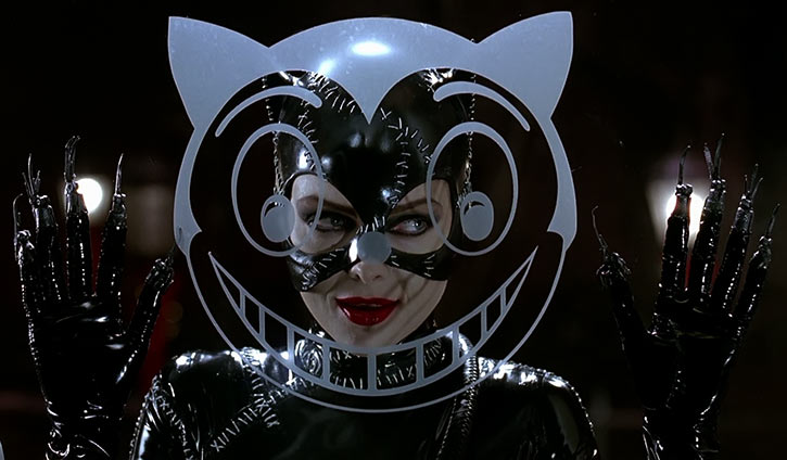 Catwoman (Michelle Pfeiffer) (Batman Returns 1992 movie) behind cat face on window