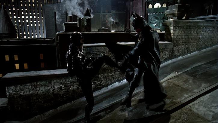 Catwoman (Michelle Pfeiffer) (Batman Returns 1992 movie) fights Batman rooftop