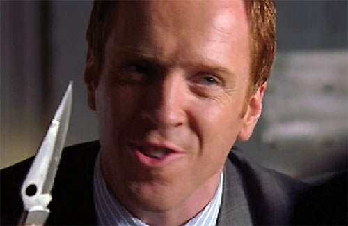 Charlie Crews (Damian Lewis in the Life TV series) with a peeling knife