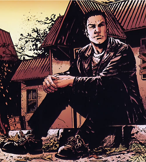 Chas Chandler (Hellblazer DC Comics) sitting on a sidewalk
