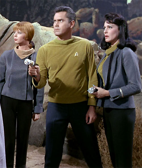 Captain Christopher Pike (Jeffrey Hunter in Star Trek) with his staff