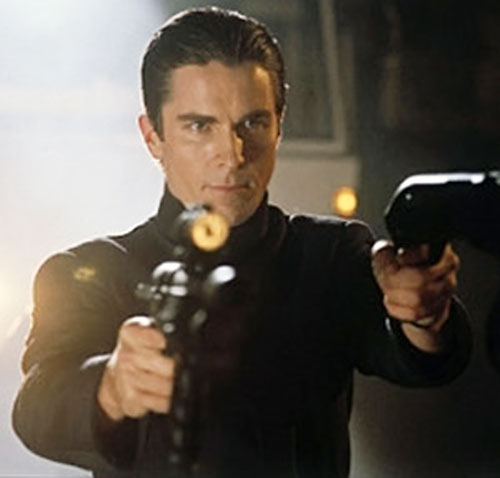 John Preston (Christian Bale in Equilibrium) pointing a SMG and a shotgun