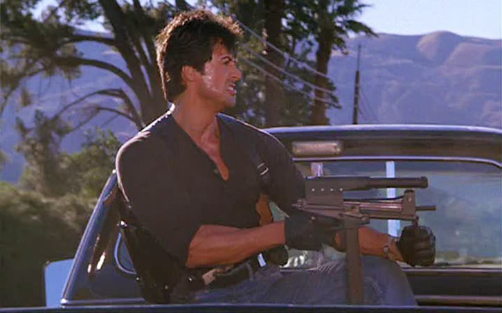 Marion Cobra Cobretti (Sylvester Stallone) with Jati submachinegun and laser sight
