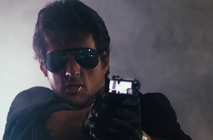 Marion Cobra Cobretti (Sylvester Stallone) with mirrorshades and .45