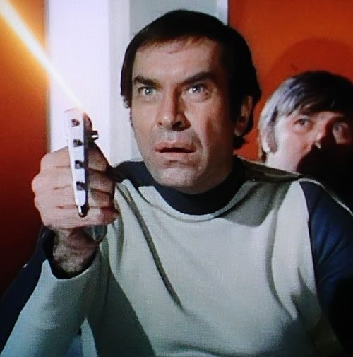 Commander Koenig (Martin Landau) (Space 1999) using his weapon