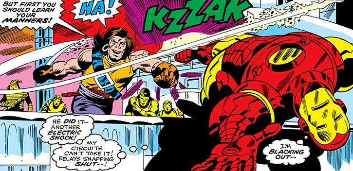 Commander Kraken hits Iron Man with his sabre